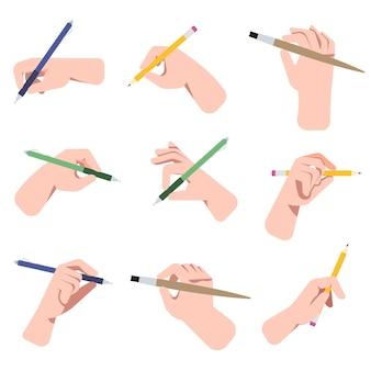 Mani che tengono penne, matite e set di illustrazioni di pennelli