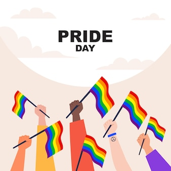 Hands holding and raising lgbt pride flag. happy pride day