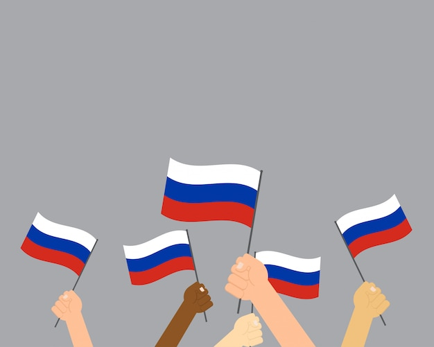 Hands holding russia flags isolated on gray background