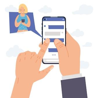 Руки, держащие смартфон обмена сообщениями