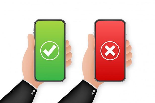 チェックマークが設定されたスマートフォンを持っている手。チェックマークとクロスチェック。図。