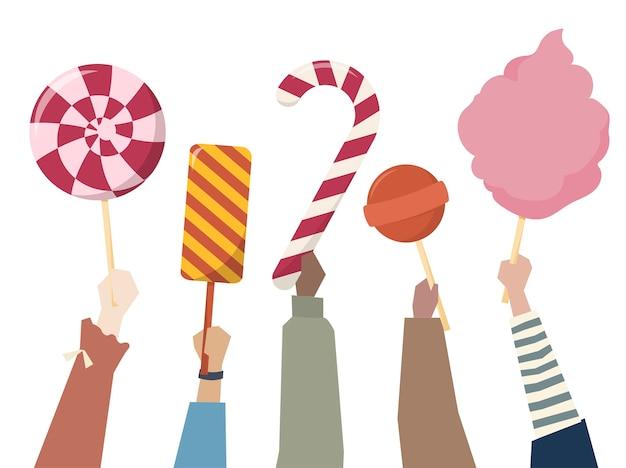 お菓子、キャンディーを手に持つ手