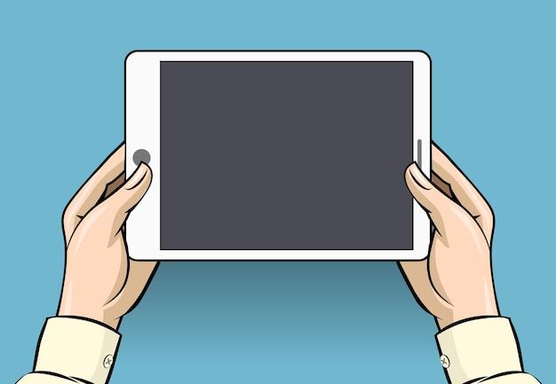 タブレットコンピュータを保持している手。スクリーンデジタルディスプレイ、タッチスクリーンおよびデバイス
