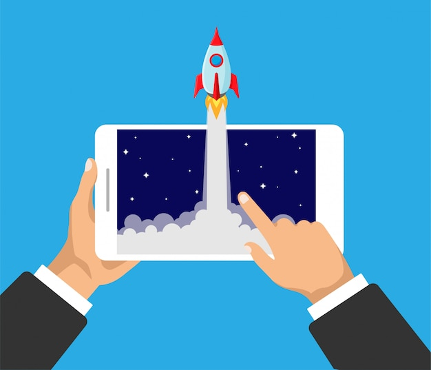 Hands holds smartphone with rocket launch on a screen. business product concept. project start up and innovation product.