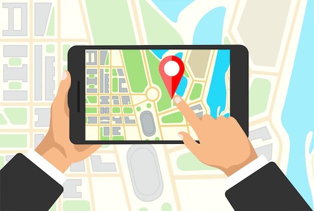 Руки держит планшет с карты навигации на экране. gps-навигатор с красной точкой. карта города с точечными маркерами.