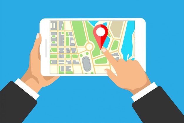 Hands holds tablet with map navigation on a screen. gps navigator with red pinpoint. city map with point markers.