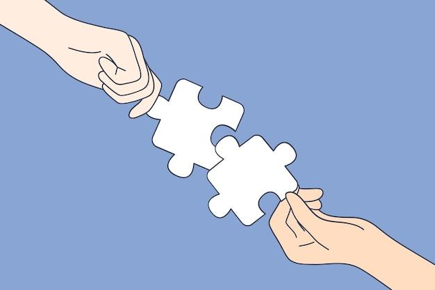一緒にパズルの詳細の全体像を作る人々の手