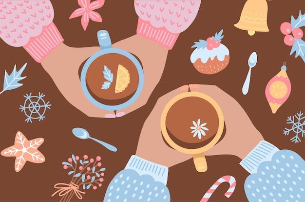 テーブルの周りに座ってクリスマスを祝う人々の手、装飾されたクッキーでお茶を飲む