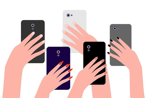 Руки людей с мобильными телефонами группа людей, мужчин и женщин, снимает фото и видео на смартфон