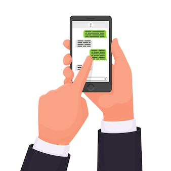 Руки, которые держат смартфон. онлайн чат. коммуникатор. общение в сети. смс сообщение