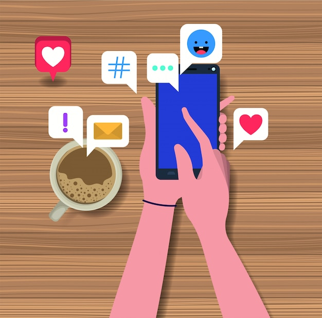 Hands using smartphone with coffee cup and social icons