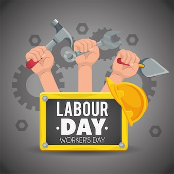 Hands with construction tools to labour day