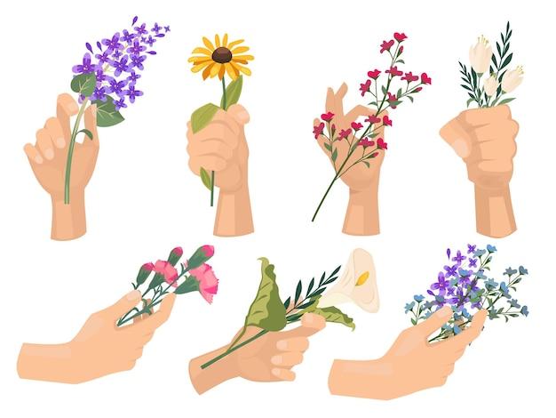꽃과 손. 야생화와 함께 아름 다운 꽃다발을 들고 꽃집 사람들.
