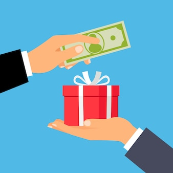 Hands with money and gift box
