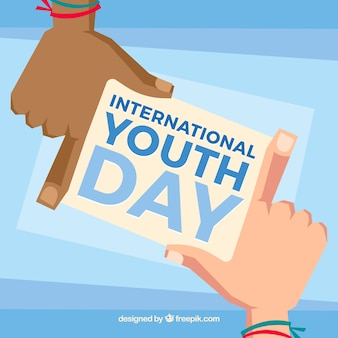 Hands with note of international youth day background