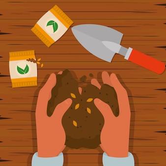 Руки с почвой и семенами