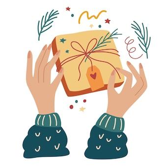손으로 크리스마스 선물을 포장합니다. 크리스마스 선물 상자를 포장합니다. 축하 크리스마스 이브 또는 새해를 위한 준비. 평면도. 플랫 만화 벡터 일러스트 레이 션.