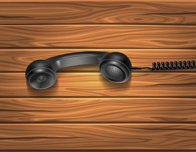 Handset on wooden background