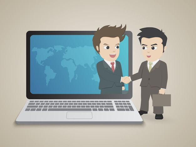 Handshake of two business people with laptop.