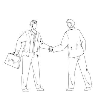 Handshaking businessmen after success deal
