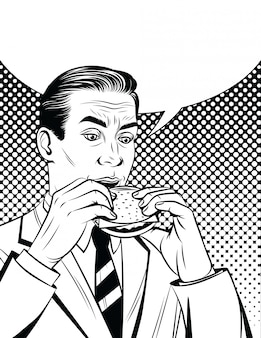 Handsome adult man in suit having lunch break with unhealthy food