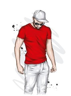 Красивый спортивный парень в стильной футболке и кепке