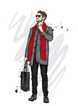 Красивый парень в стильной одежде