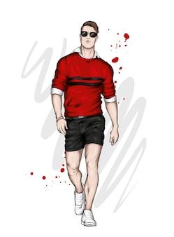 Красивый парень в стильных шортах и свитере