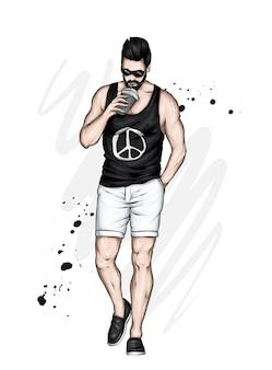 Красивый парень в стильной футболке и шортах