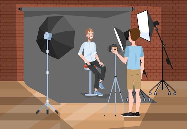 スタジオで写真撮影をするハンサムな男
