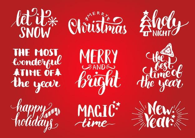 お祝いの装飾が施された手書きのクリスマスと新年の書道。ハッピーホリデー、ホリージョリーなどのレタリング。