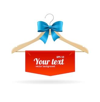 あなたのテキストのためのスペースがある店のためのハンガーと弓の販売コンセプト。