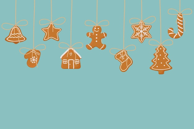 Hanging gingerbread cookies on blue background christmas template for banner greeting card