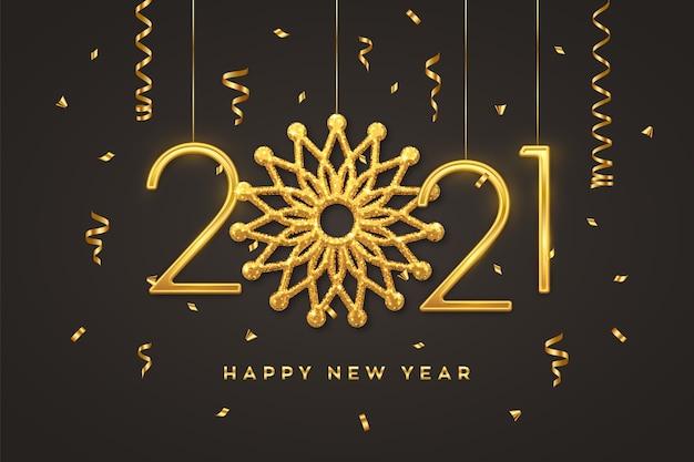 黒の背景に雪の結晶と黄金の金属番号2021をぶら下げます。新年のグリーティングカード。