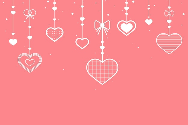 Hanging hearts on pink background