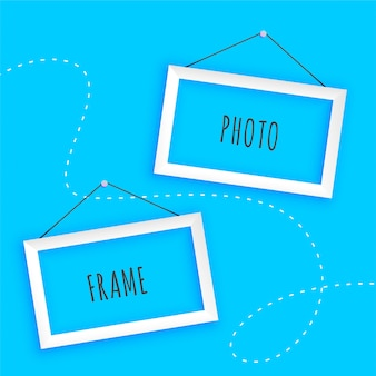 Hanging photo frames on blue background
