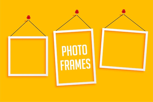 Hanging photo frames on yellow