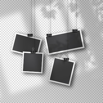 Hanging photo set in vintage style on soft transparent background. realistic retro photo templates suspended on metal clips. soft organic shadow overlay from window and environment.
