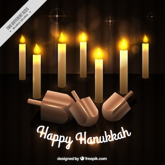 Hanukkah background with burning candles and spinning tops