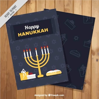 Hanukkah greeting card with candelabra and gifts in flat design