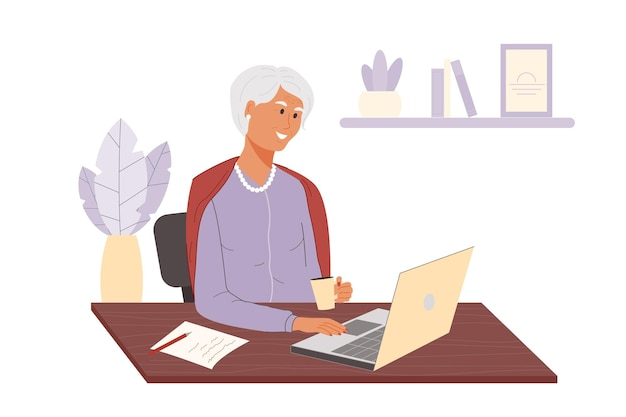 幸せな大人の女性はコーヒーを飲み、自宅でラップトップを使用して椅子に座っている年配の女性の笑顔