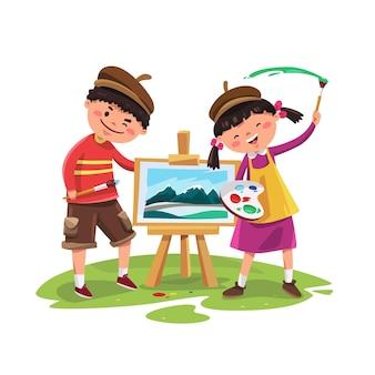 幸せでかわいい男の子と女の子がキャンバスに描く