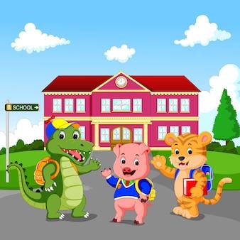 학교 건물 앞에 서있는 행복 동물 만화