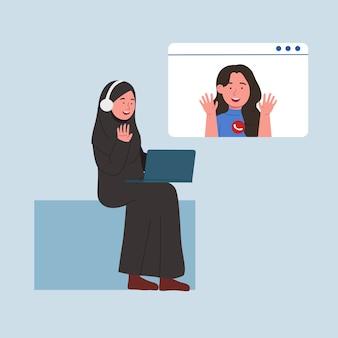 Happy arabian women video call with friend
