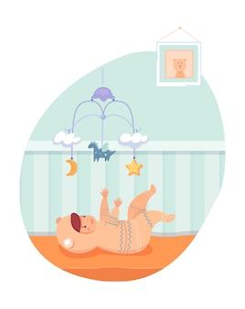 ベビーベッドに横たわって、モバイルで遊ぶ幸せな女の赤ちゃん Premiumベクター