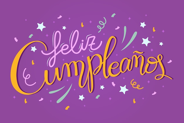 Happy birthday in spanish lettering with fireworks