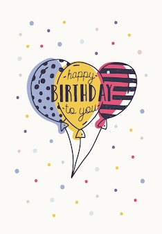 Happy birthday to you inscription handwritten with elegant calligraphic font on colorful balloons and decorated with confetti