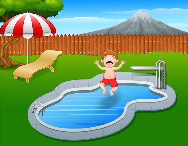 Happy boy cartoon jumping in swimming pool