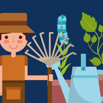 Happy boy holding pitchfork watering can and flower plant garden