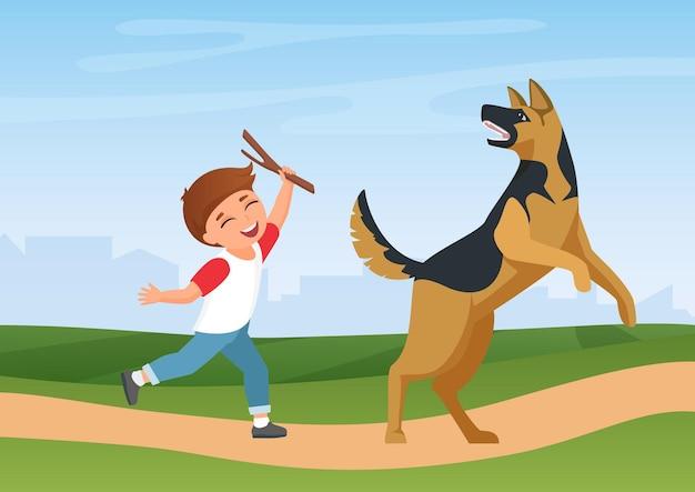 Счастливый мальчик ребенок тренируется, играя с собакой в природе, летний парк, пейзаж, время веселья